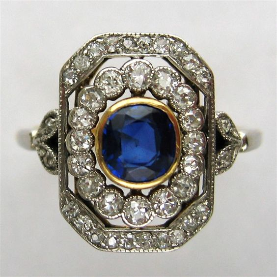 An edwardian sapphire and diamond double cluster ring for Bentley and skinner jewelry
