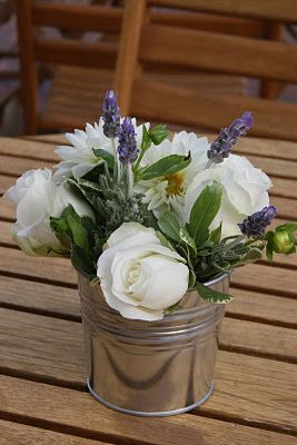 Simple-and-stunning purple-and-white centerpiece arranged in a silver bucket....