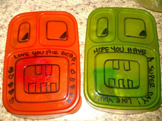 """Magdalena shared this on our Facebook Page. She wrote, """"This is how I include a serving of love with every lunch :) These are for my 2nd grader and pre-k'er. I do the same on my husband's lunch too! Dry erase marker makes it super easy!""""  What a GREAT idea!"""