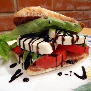 Miss Mochi's Adventures: Caprese Sandwich. 1 ripe tomato sliced thick, fresh mozzarella cheese, 3 tbs balsamic vinegar, 3 tbs olive oil, fresh basil leaves, 2 ciabatta rolls, optional: balsamic glaze/reduction*