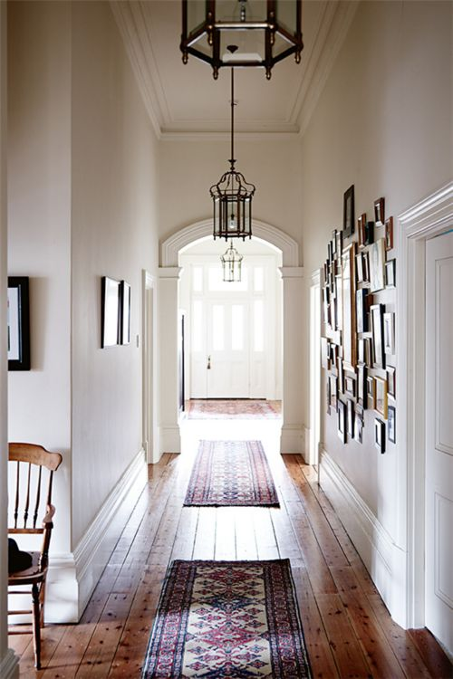 High skirting boards and wooden floor is cool - like the spacious and bright corridor and the archway thing.:
