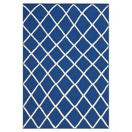 Hand-woven wool rug with a lattice motif.   Product: RugConstruction Material: WoolColor: Dark blueFeatures:  FlatweaveMade in India Note: Please be aware that actual colors may vary from those shown on your screen. Accent rugs may also not show the entire pattern that the corresponding area rugs have.Cleaning and Care: Professional cleaning is recommended