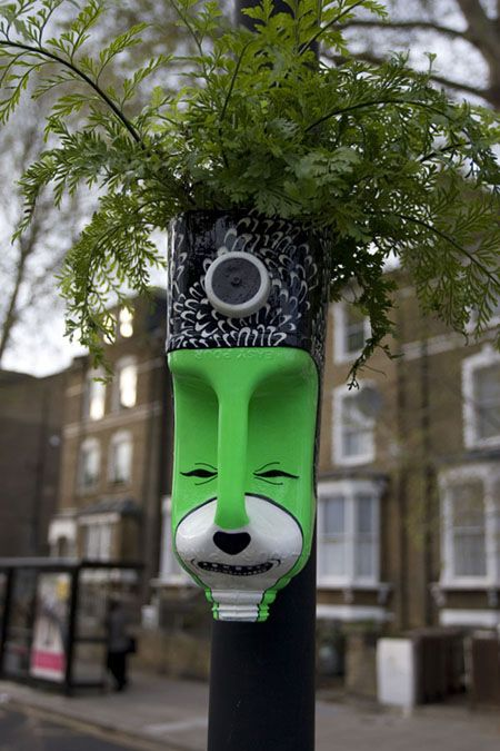 gardening project made of recycled empty milk bottles painted with guerilla images
