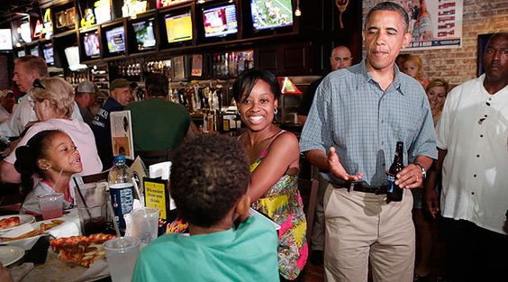 President Barack Obama greets a family at Ziggy's Pub in Amherst, Ohio July 5, 2012. Obama is on a two-day campaign bus tour of Ohio and Pennsylvania. REUTERS/Kevin Lamarque