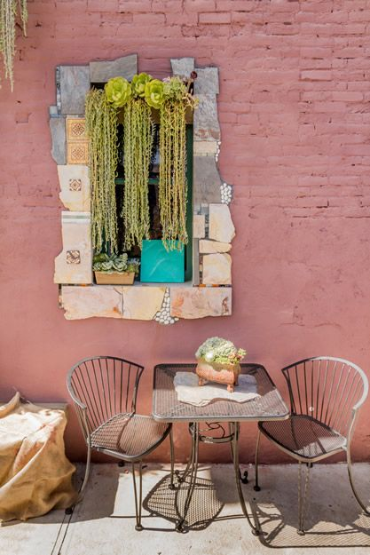 A succulent display doubles as a window valance. (Photo by: Kole Montross) at The Succulent Cafe in Oceanside, CA