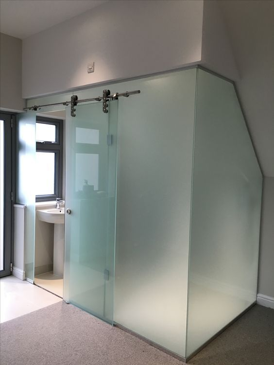 A Bathroom Cubicle Clad With Frosted Glass And With A Main Sliding Door Is A Bold Idea For A Modern Glass Shower Enclosures Glass Bathroom Door Shower Cubicles