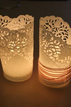 Doilies wrapped around glass jars with candles inside and wrapped with twine or ribbon. Perfect for the cake table or guest tables.
