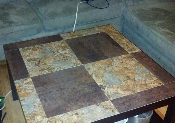 Plain black IKEA table that was scratched. Bought $0.68 sticky floor tile and covered the top. So glad we did this!