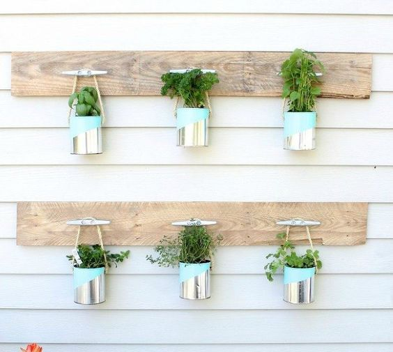 s 16 empty tin can hacks that will make your home look amazing, crafts, home decor, repurposing upcycling, Use painted cans for a hanging planter: