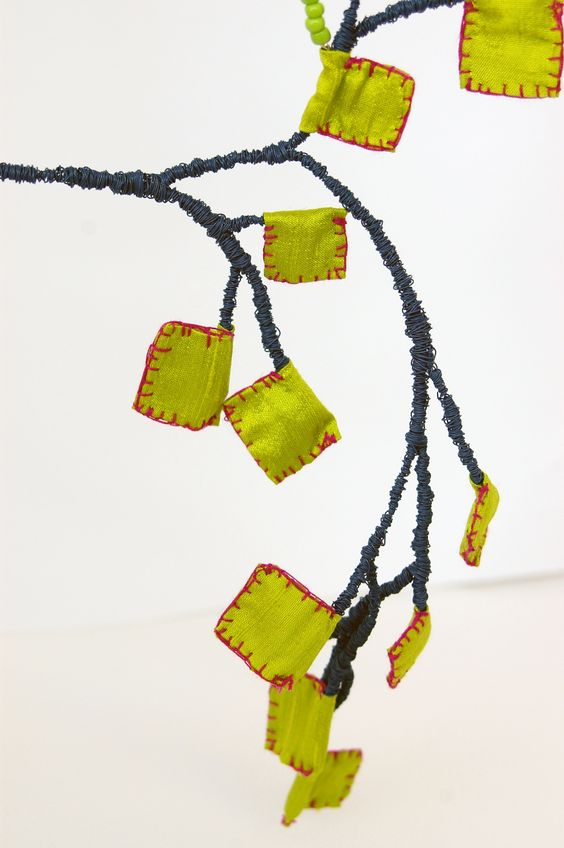 Eleftheria Spantidaki - Fylaxta means Amulets Colored wire, silk fabric, glass beads  http://www.the2astudio.com/:
