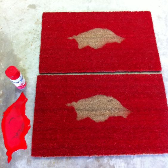 Spray paint,  old sticker, outdoor mats!  Ready for some Razorback Football!!  Woo pig sooie!