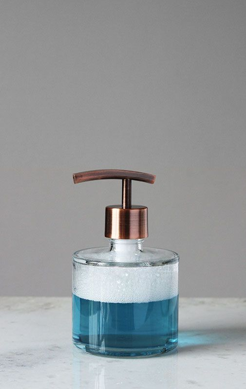 Shop small soap dispensers for your kitchen or bathroom with the Seaside Spa Glass Soap Dispenser. The clear glass base has a real metal soap pump in stainless, chrome, bronze, copper and gold for a finished look. Perfect for your favorite soap or lotion. Holds 8 ounces. | Shop Soap Dispensers at RAIL19.com ✓ FREE SHIPPING on orders over $25.