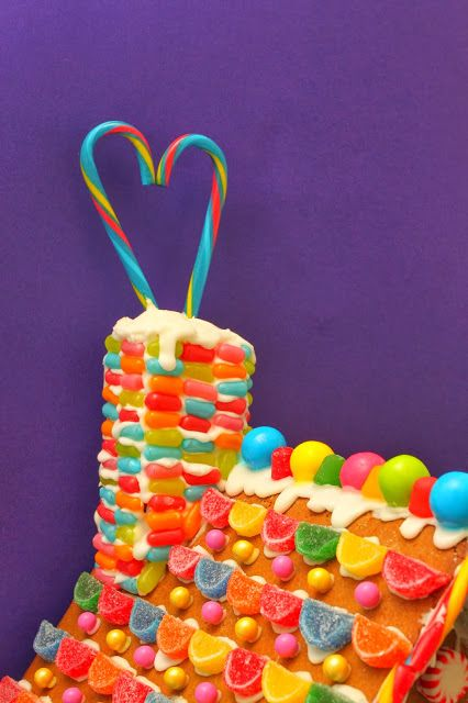 Beautiful juicy fruit colors on gingerbread house with candy cane fireplace chimney