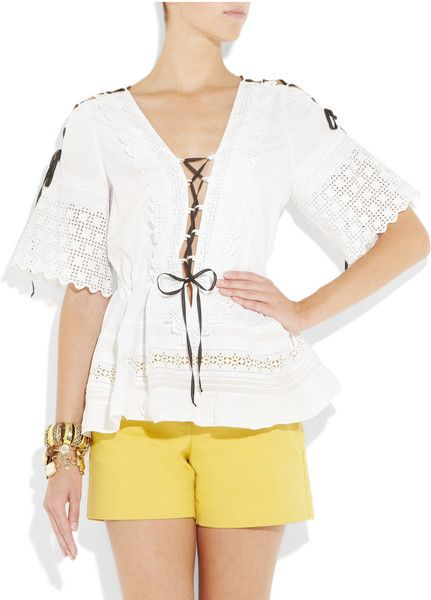 ONE VINTAGE  White semi-sheer cotton tunic with Edwardian lace panels at wide short sleeves. One Vintage tunic has a low V-neck and slit shoulders with cotton rivets and interlacing black ribbon to self-tie, pintucked pleats and lace-overlay panels, and gathering at waist