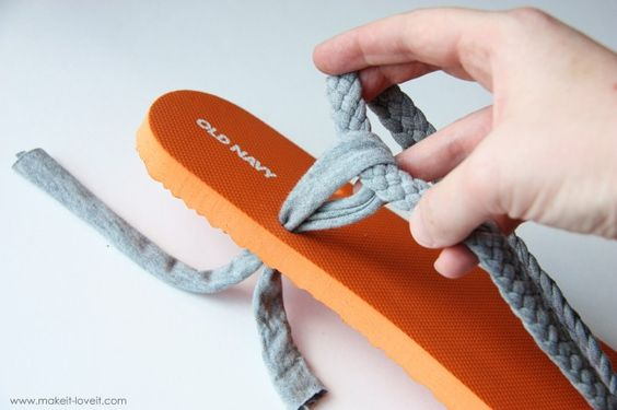 DIY  ::  flip flop ( link  ::  http://www.makeit-loveit.com/2011/07/flip-flop-refashion-part-1-braided-straps.html  )