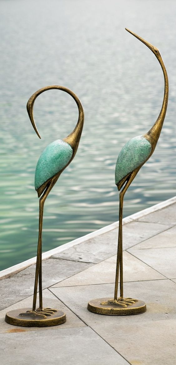 bring exotic new life to your patio or pool deck with our dramatically sculptural outdoor crane pair