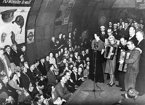 A concert given by ENSA (Entertainments National Services Association) to people sheltering in Aldwych station on 9th October 1940.