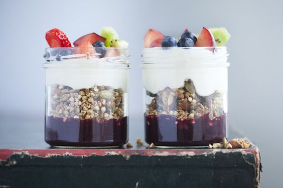 raw sprouted granola with yogurt, blueberry sauce and fresh fruit