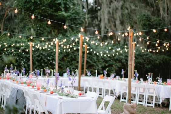 We love the globe lights festooned above this intimate wedding reception.: