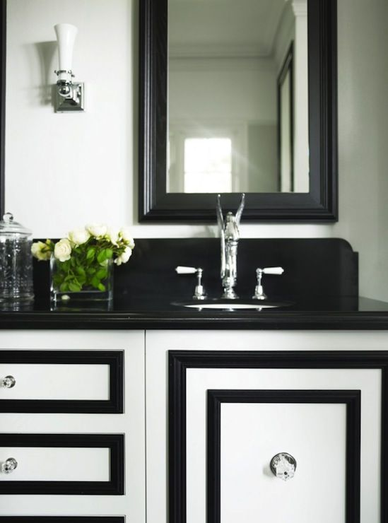 add pizazz to plain bathroom cabinets by adding molding in a contrasting color transitional bathroom black and white bathroom furniture