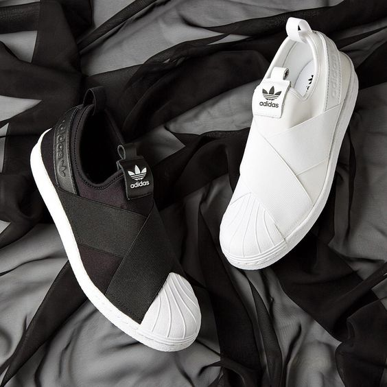 Choose a side? The adidas Originals Superstar Slip On Trainer is available in womens mens sizes. Clothing, Shoes Jewelry - Women - Shoes - womens shoes - amzn.to/2jttl6P #womensshoes