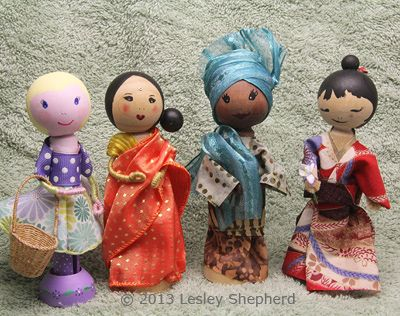 Clothespin dolls lend themselves to customization. These dolls have been given contemporary or national dress for celebrations of Mother's Day.