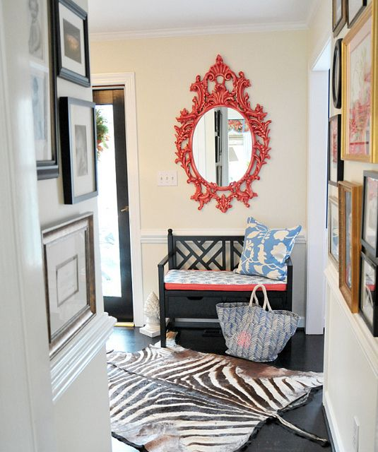 furbish, entryway, coral red mirror, black bench, animal hide rug  Screen shot 2012-07-24 at 9.53.12 PM by jamie meares, via Flickr