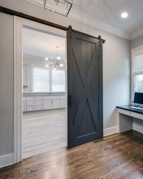 Dark Grey Painted Wood Barn Door With Hardwood Floors And White Painted Trim Grey Interior Doors Wood Barn Door Indoor Barn Doors