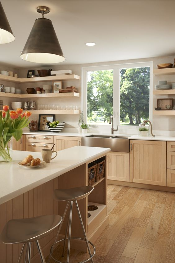 light filled kitchen with wood floors and casement windows