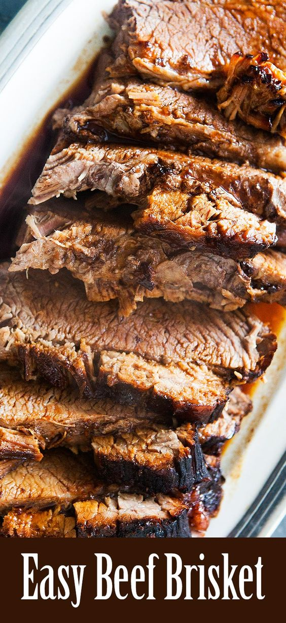 Easy Beef Brisket! Beef brisket roast, slathered in a mixture of BBQ sauce and soy sauce, wrapped in foil, and baked until falling apart tender. Only 3 ingredients! Get the recipe on SimplyRecipes.com #Passover