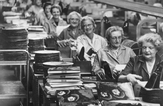 Ladies in a factory, putting together copies of The Beatles' 'Rubber Soul', 1965.