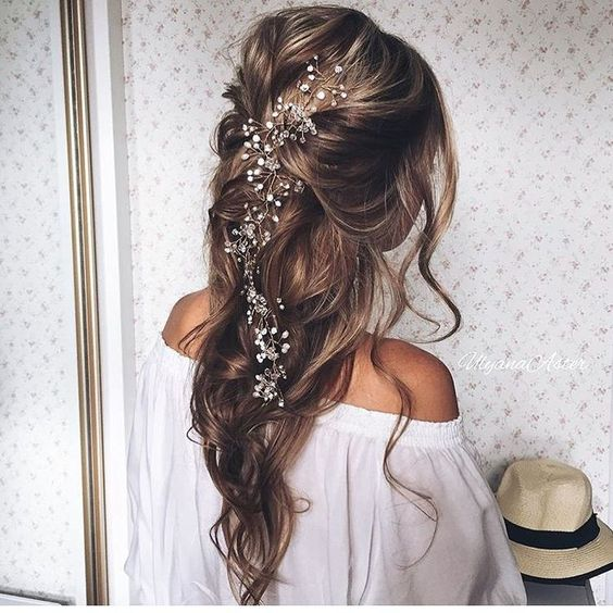 A relaxed loose wedding hairstyle from Modern Salon via Instagram