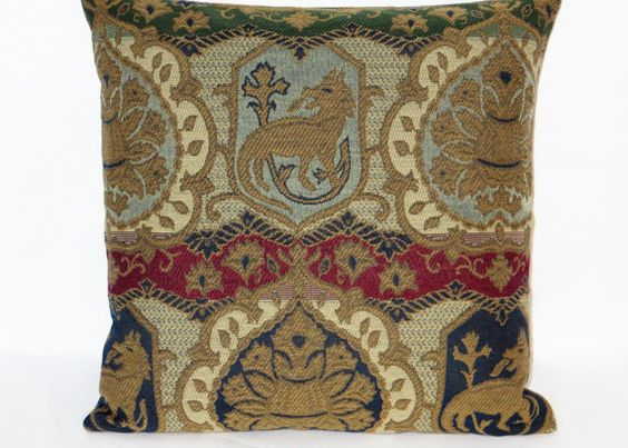 This 17 x 17 pillow is created from a beautifully detailed brocade upholstery fabric. A medieval theme with a griffon motif, in subtle tones of