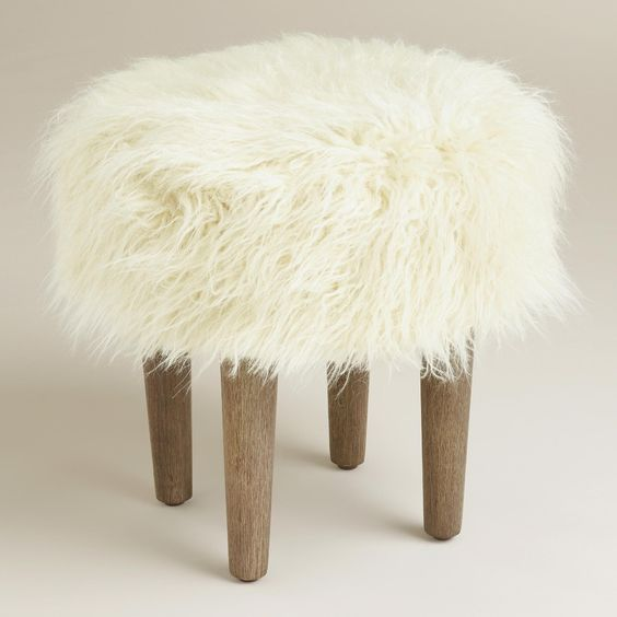 Featuring a plush, natural-toned faux fur top inspired by the flokati wool shag rugs of Greece, our fun and modern hardwood footstool is ideal in front of an accent chair or at the foot of a bed.: