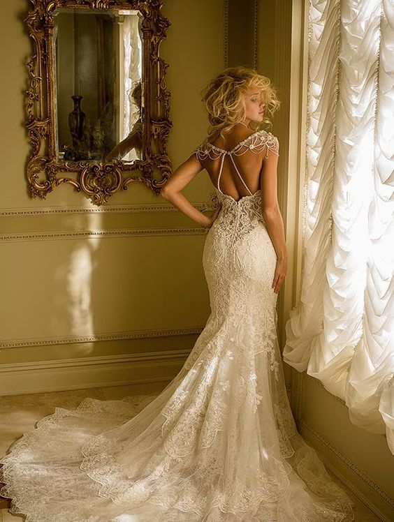 Love the intricate design of this Eve of Milady wedding dress; click to see more gorgeous gowns from this collection.