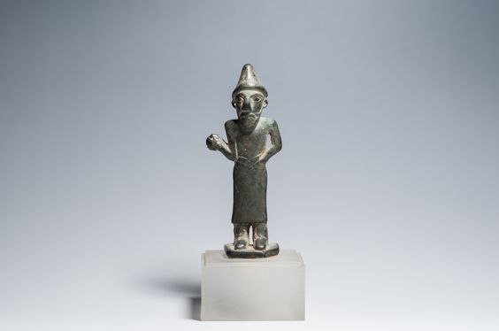 A Standing Human Figure Bronze, 8.2 x 3.2 x 1.1 cm Mesopotamia, first millennium BC Reference: Roman Ghirshman, Persia, From the Origins to Alexander the Great, London, 1964