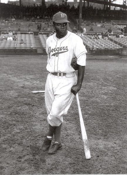 April 17, 1947 Jackie Robinson playing for the Brooklyn Dodgers performs a bunt for his 1st major league hit.