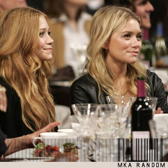 Mary Kate and Ashley Olsen looking happy and fashionable
