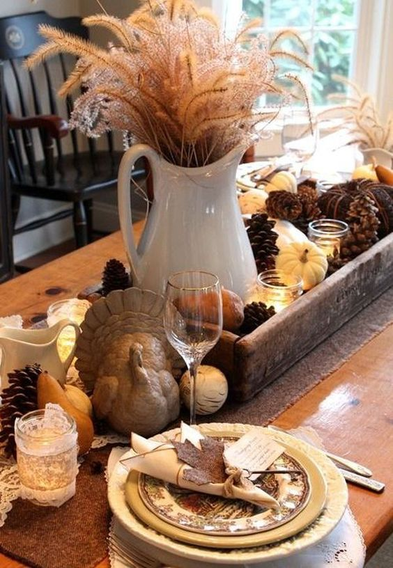 You can create a rich table arrangement for the center using pine cones and tiny pumpkins: