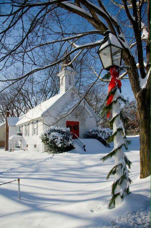 Snow covered church at Christmas: