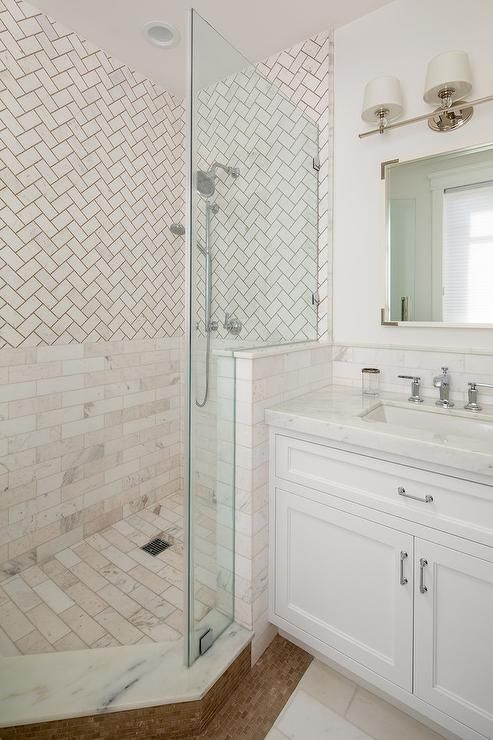 Stunning Mix Pattern Shower Appeals To The Marble Lover Starting With Ivory Herringbone Shower Tiles On T Shower Tile Transitional Bathroom Herringbone Pattern