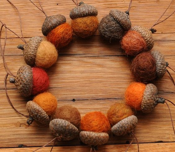 Add foraged acorn caps to handmade felted wool balls, add a loop for hanging if you wish, and you've made adorable felted acorns!