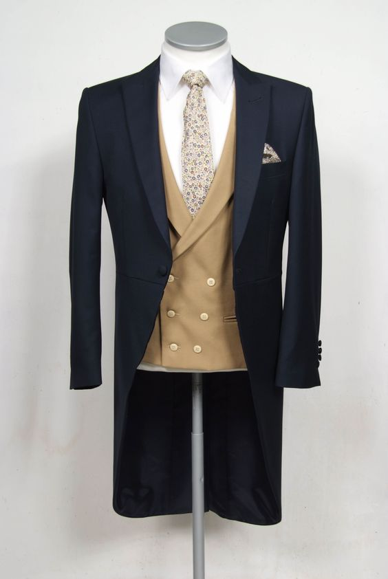 """grooms wedding tails suit navy slim fit in light weight wool with double breasted waistcoat. Mens sizes from 32"""" chest upward and include extra short, short, regular, long and extra long fittings. Boys sizes from 20"""" to 34"""" chest. Complete outfit includes jacket, skinny trousers, hire or matching waistcoat, brand new traditional or French wing slim fit shirt in white or ivory, tie or cravat, braces and cufflinks. £195.00 to hire #groom #wedding #suit #hire #suithire #waistcoat #navy #groom"""