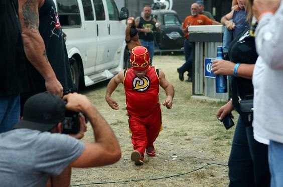 "Wrestler ""Demo"" makes his way to the ring as he is introduced during his Micro Wrestling Federation match Tuesday night at the Full Throttle Saloon in Sturgis. (Journal file) #sturgis #SouthDakota #wrestling"