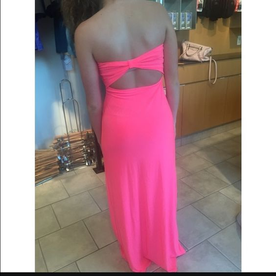 Neon pink strapless maxi dress Charlotte Russ neon maxi dress , has never been worn before . Love this dress ! Has a cut out open back Dresses Maxi