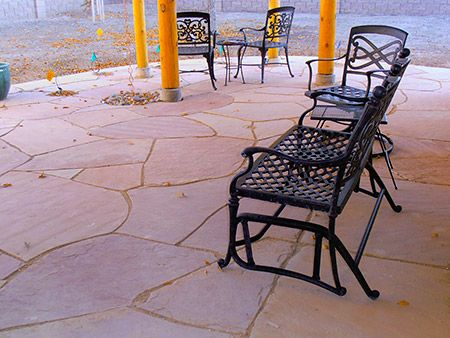 Flagstone patio set in crusher fines with 'Rain Chain' to french drain