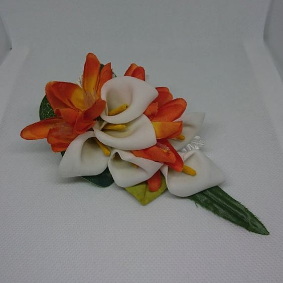 Ladies White cala and orange lapelwristhandbag corsage