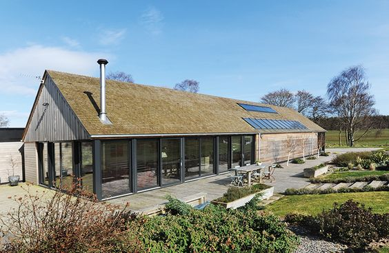 Single-storey open plan home with glass and timber cladding   Self-build.co.uk
