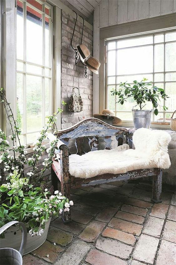 Beautiful sun room. I would fill this space with plants, vases and maybe a rug