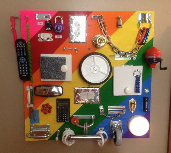 Ultimate busy board !!!  Has removable Velcro pics under each door.